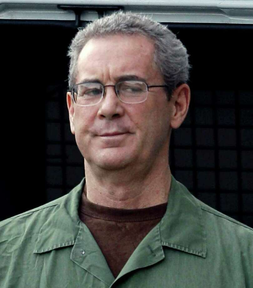 In this Aug. 24, 2010 file photo, jailed Texas tycoon R. Allen Stanford arrives in custody at the federal courthouse in Houston.  Stanford, charged with bilking investors out of $7 billion in a massive Ponzi scheme, was found guilty on 13 of 14 counts by a jury Tuesday, March 6, 2012, in Houston.  (AP Photo) Photo: David J. Phillip, Associated Press / AP2010