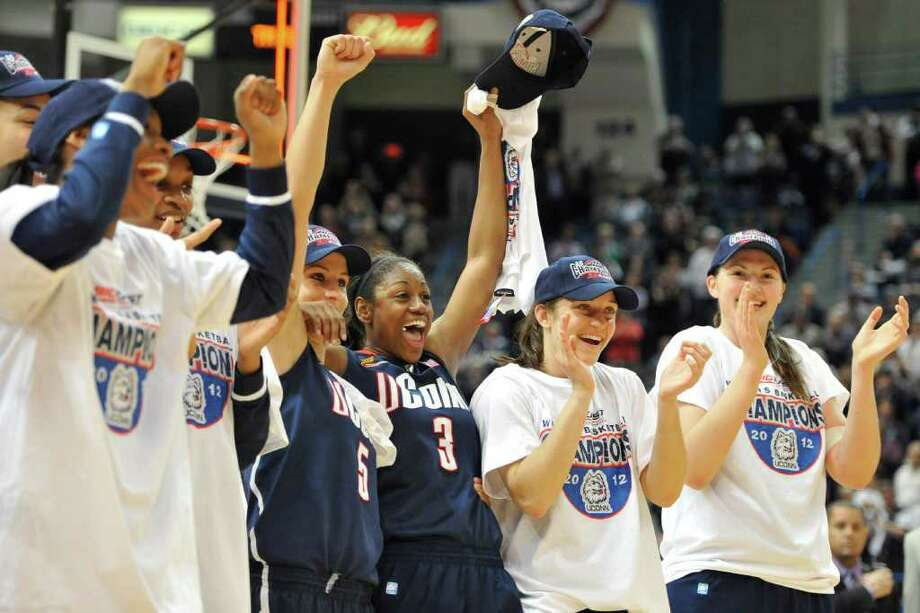 Connecticut players celebrate a 63-54 win over Notre Dame in an NCAA college basketball game in the final of the Big East women's tournament in Hartford, Conn., Tuesday, March 6, 2012. (AP Photo/Jessica Hill) Photo: Jessica Hill, Associated Press / AP2012