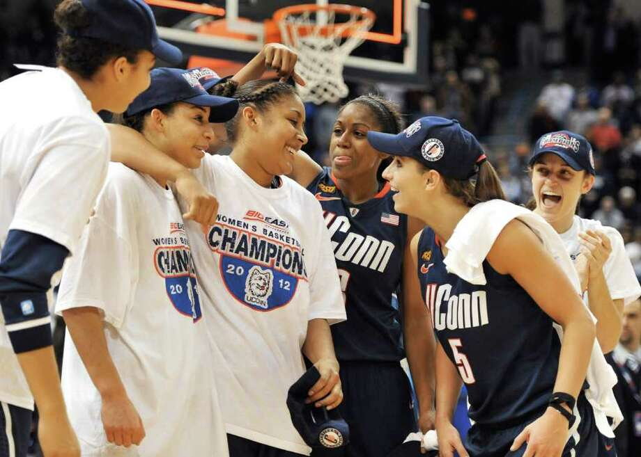Connecticut's Tiffany Hayes, third from right, teases, Kaleena Mosqueda-Lewis, third from left, as Mosqueda-Lewis is announced as Most Outstanding Player after Connecticut's 63-54 win over Notre Dame in an NCAA college basketball game in the final of the Big East women's tournament in Hartford, Conn., Tuesday, March 6, 2012. (AP Photo/Jessica Hill) Photo: Jessica Hill, Associated Press / AP2012
