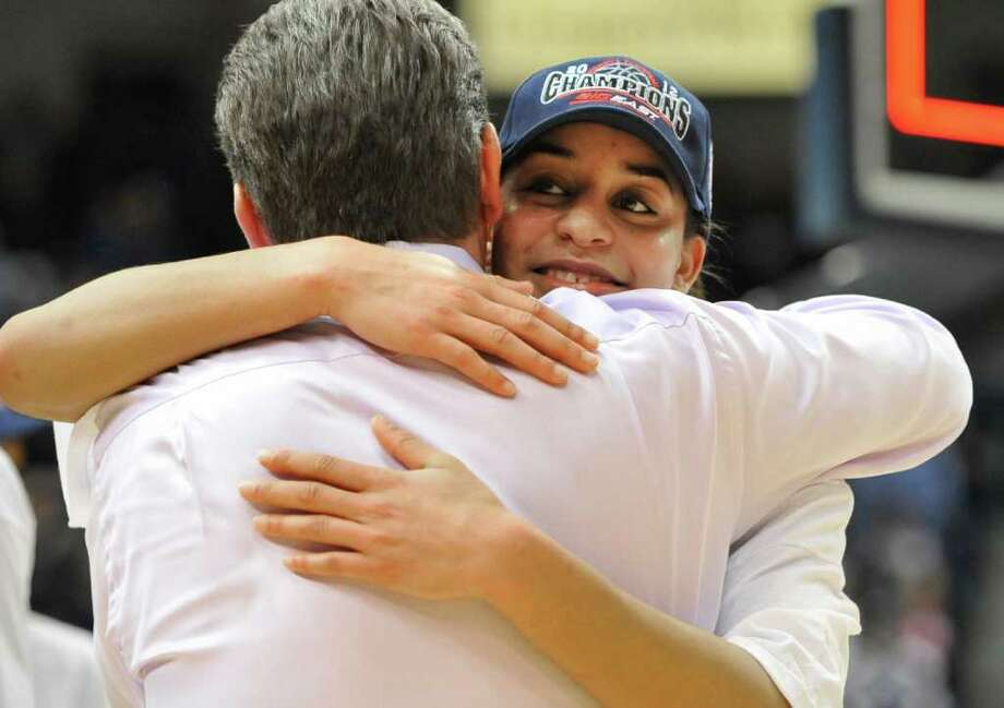 Connecticut's Bria Hartley, right, hugs coach Geno Auriemma after Connecticut's 63-54 win over Notre Dame in an NCAA college basketball game in the final of the Big East women's tournament in Hartford, Conn., Tuesday, March 6, 2012. (AP Photo/Jessica Hill) Photo: Jessica Hill, Associated Press / AP2012