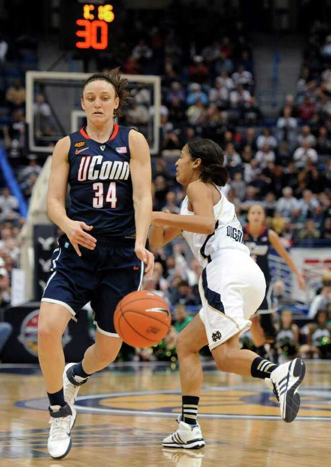 Connecticut's Kelly Faris (34) steals the ball from Notre Dame's Skylar Diggins, right, in the final minutes of an NCAA college basketball game in the final of the Big East women's tournament in Hartford, Conn., Tuesday, March 6, 2012. Connecticut won 63-54. (AP Photo/Jessica Hill) Photo: Jessica Hill, Associated Press / AP2012