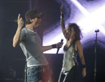 Enrique Iglesias performs for his Euphoria Tour at the Toyota Center in 2011. (Nick de la Torre / Houston Chronicle)