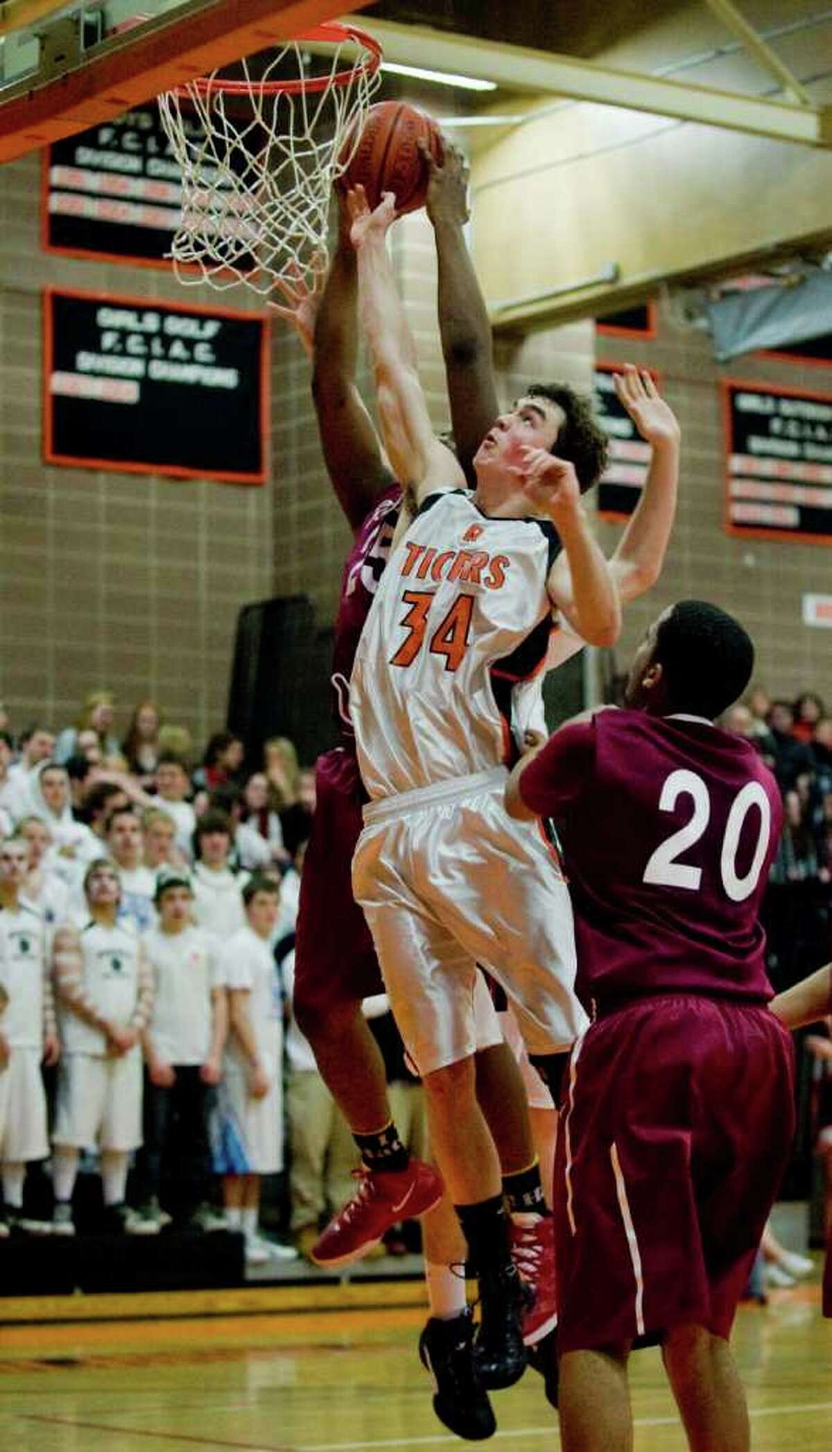 Ridgefield High School's Seth von Kuhn goes up for a shot against Bulkeley High School in a game played at Ridgefield. Tuesday, Mar. 6, 2012