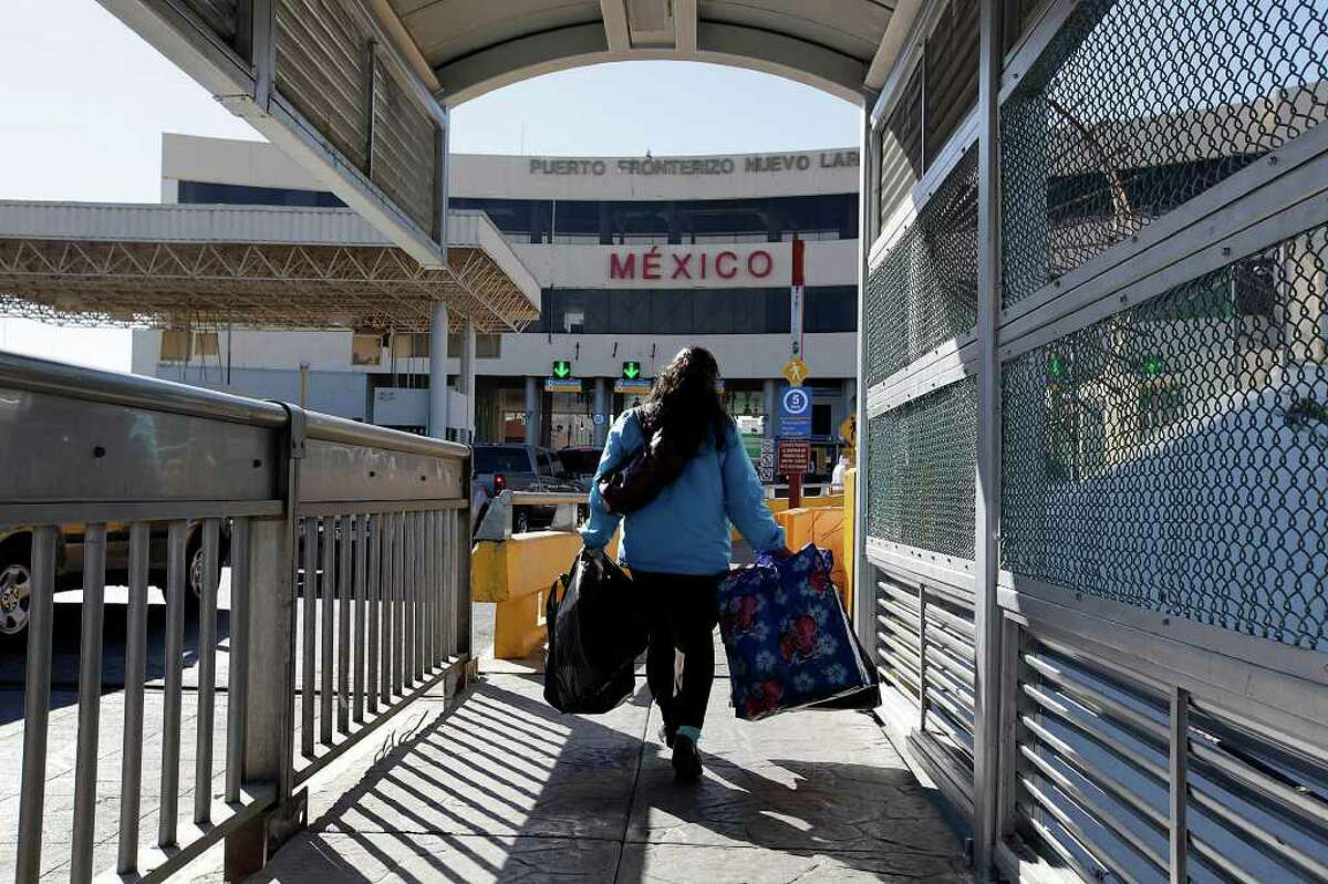 A pedestrians crosses an international bridge into Nuevo Laredo, Mexico. Some people feel such trips are dangerous.