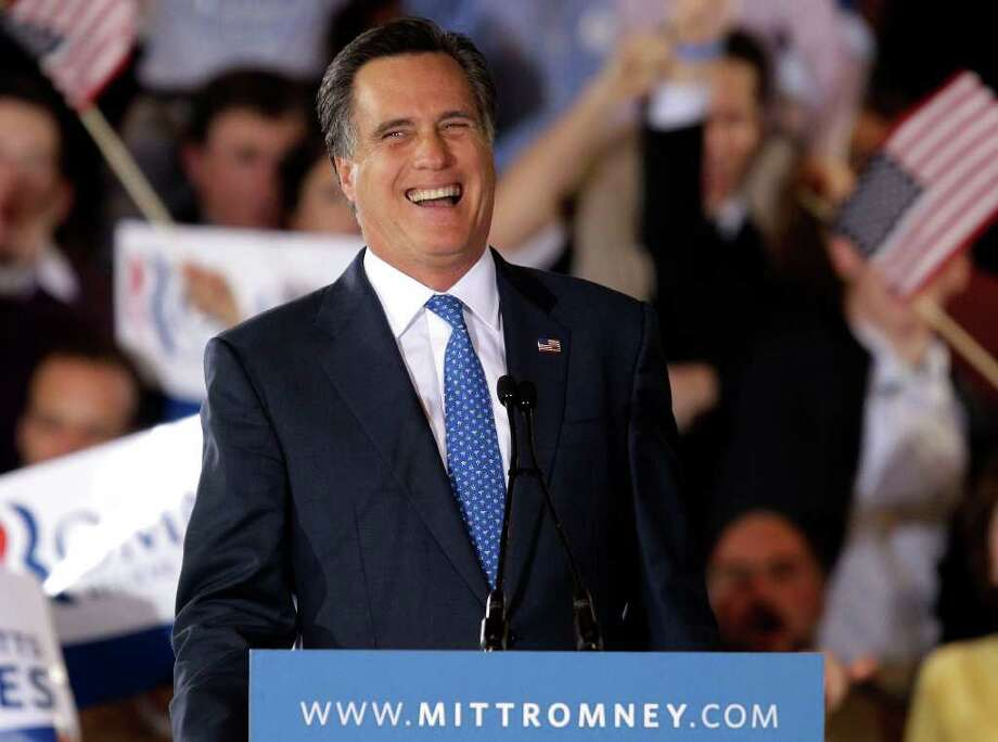 Republican presidential candidate, former Massachusetts Gov. Mitt Romney smiles as he addresses supporters at his Super Tuesday campaign rally in Boston, Tuesday, March 6, 2012. Photo: AP