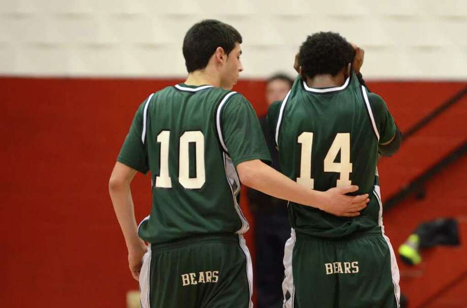 Norwalk's Nick Boccanfuso (10) consoles teammate Jabari Dear (14) during the last seconds of the first round of the Class LL state boys basketball tournament against Fairfield Prep at Alumni Hall at Fairfield University on Tuesday, Mar. 6, 2012. Photo: Amy Mortensen