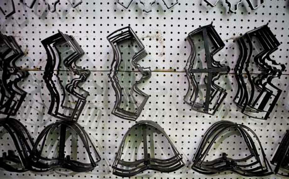 Boot cutting tools for different boot parts of the boot in different sizes are carefully hung so a cutter can have the proper tool as soon as he needs it. Photo: Nick De La Torre, Houston Chronicle / Houston Chronicle