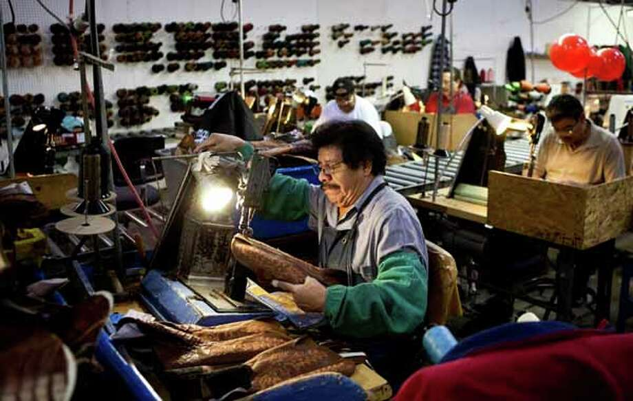 Antonio Garcia sews a pair of boots in the Lucchese Boot Company's factory in El Paso. Photo: Nick De La Torre, Houston Chronicle / Houston Chronicle