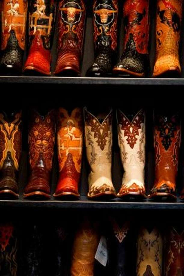 A small show room of some of Lucchese's most detailed boots shows the craftsmanship put into he product. Lucchese CEO Paul LaVoie says the factory produces 7,500 different designs.  (Nick de la Torre / Houston Chronicle)