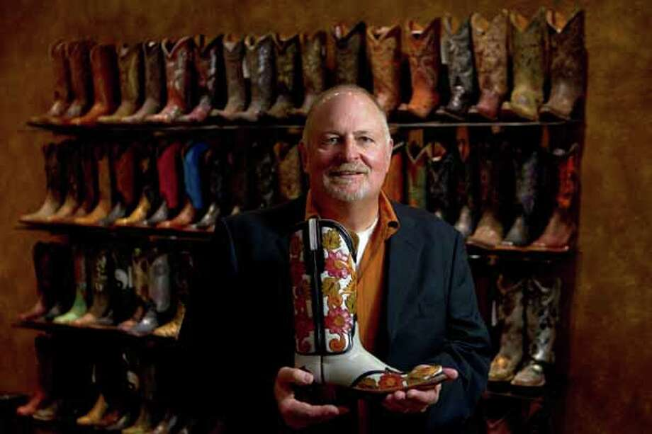 Lucchese Boot Company President and CEO Paul LaVoie shows one of his favorite boots in the Lucchese factory show room in El Paso. Photo: Nick De La Torre, Houston Chronicle / Houston Chronicle