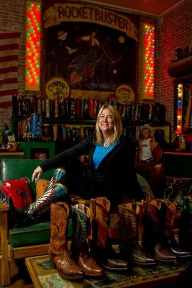 Nevena Christi of Rocketbuster Boots sits in her showroom in El Paso. Rocketbuster is located in an old fur trader's business building.  (Nick de la Torre / Houston Chronicle)