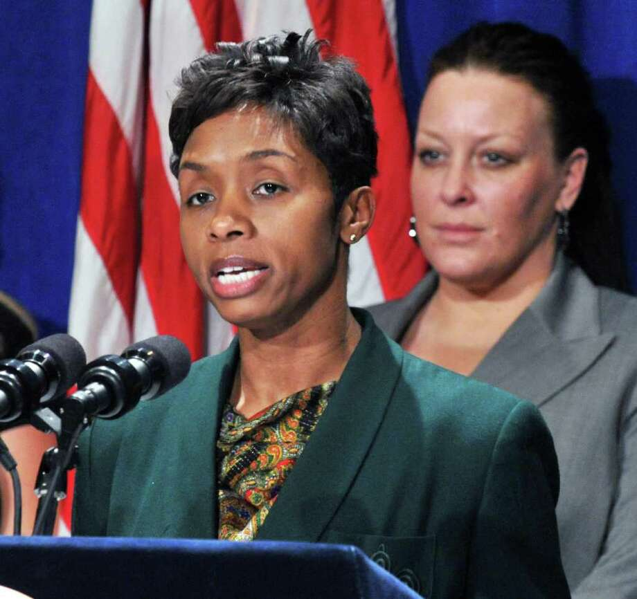 Director of the NYS Office of Victim Services Tina Stanford, joined by leading victims advocacy groups, family members and survivors of violent crimes, including home invasion victim Amy B. of Schenectady, at right, makes an announcement regarding the DNA Databank Expansion Bill at the Capitol Tuesday March 6, 2012.   (John Carl D'Annibale / Times Union) Photo: John Carl D'Annibale / 00016696A