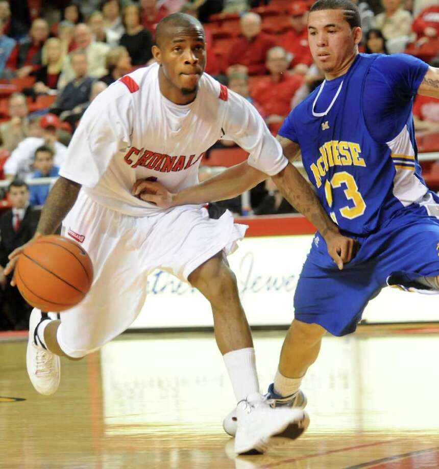 Lamar's Anthony Miles controls the ball as McNeese State's C. J. Collins guards at Lamar University in Beaumont, Saturday. Tammy McKinley/ The Enterprise Photo: TAMMY MCKINLEY / Beaumont