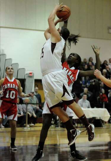 Watervliet's Mikalya Deguire goes in for a score during their Section II Class B girls' basketball t