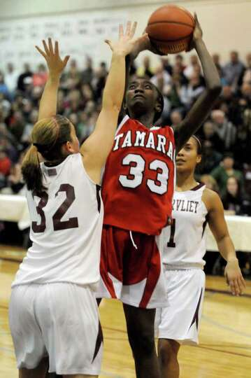 Tamarac's Adiya Henderson goes in for a score during their Section II Class B girls' basketball titl