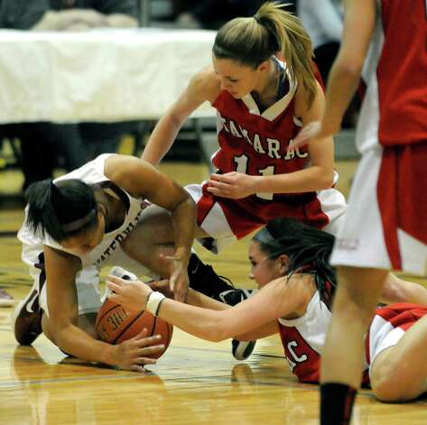 Watervliet's Ailayia Demand,left, battles for a loose ball withTamarac's Jenna Erickson and Briana Matazinsky during their Section II Class B girls' basketball title game against in Stillwater, N.Y. March 6,2011 ( Michael P. Farrell/Times Union ) Photo: Michael P. Farrell