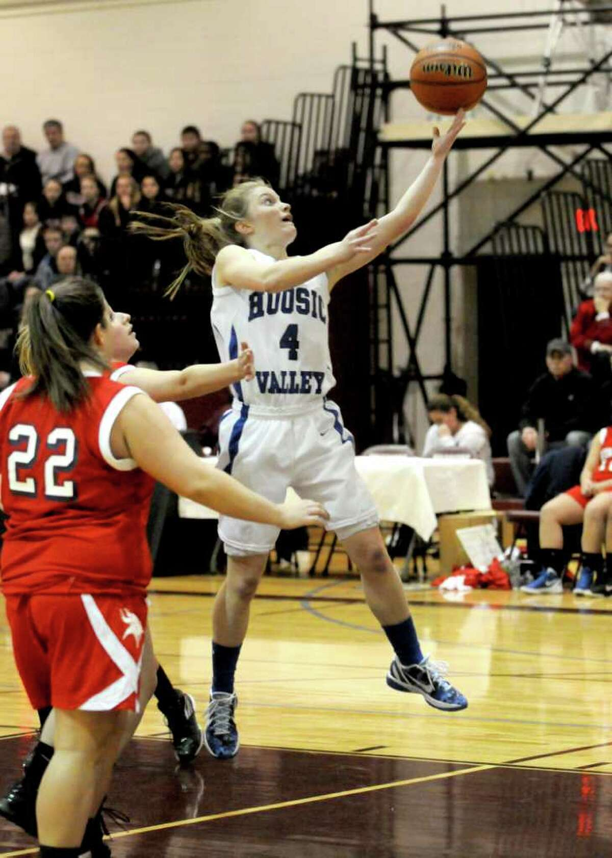 Hoosic Valley's Cassidy Chapko goes in for a basket during their girl's high school Class C state regional against Moriah in Stillwater,N.Y. March 6,2011 ( Michael P. Farrell/Times Union )