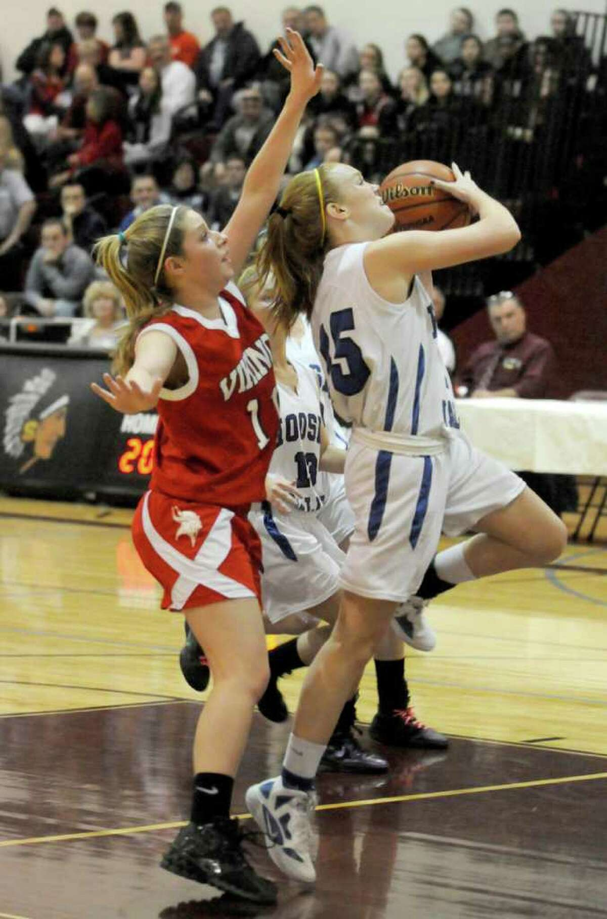 Hoosic Valley's Whitney Kugler drives to the basket during their girl's high school Class C state regional against Moriah in Stillwater,N.Y. March 6,2011 ( Michael P. Farrell/Times Union )
