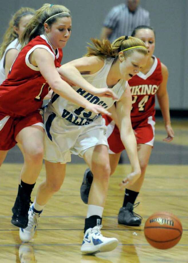 Hoosic Valley's Whitney Kugler steals the ball during their girl's high school Class C state regional against Moriah in Stillwater,N.Y. March 6,2011 ( Michael P. Farrell/Times Union ) Photo: Michael P. Farrell