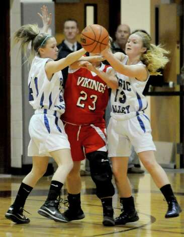 Hoosic Valley's Sydney Fitzpatrick,left, and Sam Connors,right, steal the ball from Moriah's Lauren Pelkey during their girl's high school Class C state regional in Stillwater,N.Y. March 6,2011 ( Michael P. Farrell/Times Union ) Photo: Michael P. Farrell
