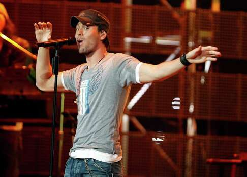 When Enrique Iglesias took to the Houston Livestock Show and Rodeo stage Tuesday night, the lusty squeals promptly commenced and so did, eventually, the tequila shots when three giddy fans joined him on stage. Photo: James Nielsen / © 2011 Houston Chronicle