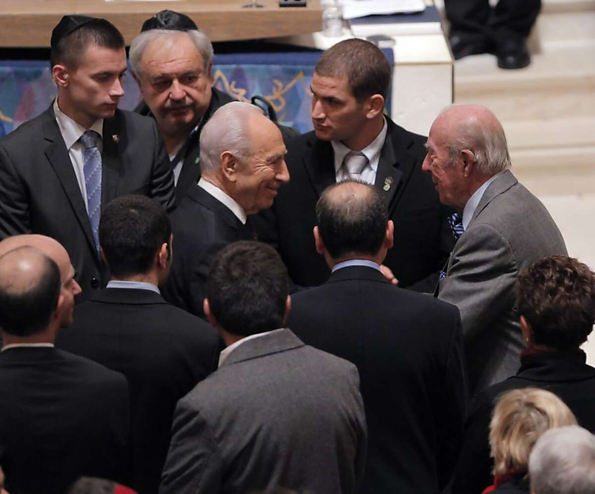 Israeli President, Shimon Peres, left, is greeted by George Shultz as he enters Congregation Emanu-El. Peres spoke to thousands gathered at Congregation Emanu-El in San Francisco, Calif., on Tuesday, March 6, 2012.