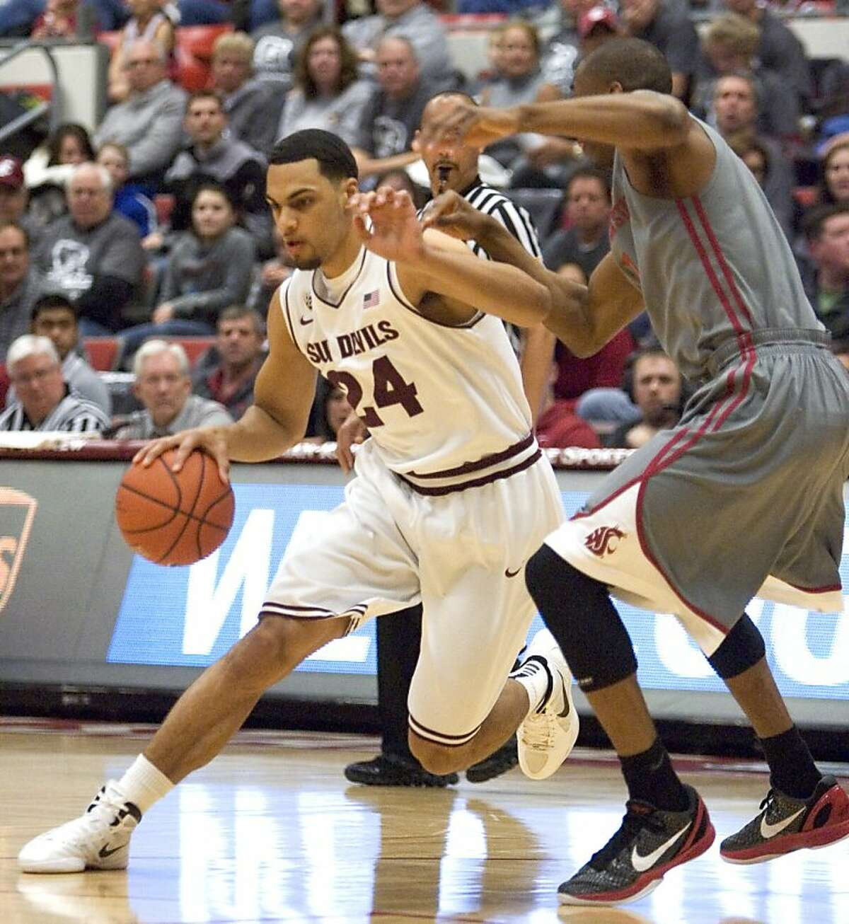 Arizona State guard Trent Lockett (24) drives on Washington State guard Marcus Capers during the first half of an NCAA college basketball game Saturday, Feb. 18, 2012, in Pullman, Wash. (AP Photo/Dean Hare)