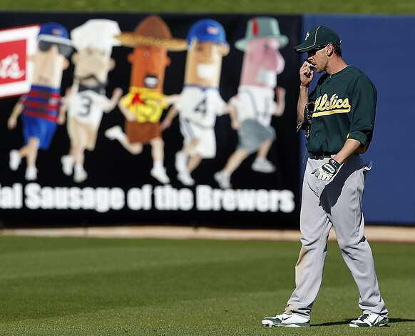 Jeff Fiorentino applies lip balm after hitting a double and scoring in the 9th inning of the Oakland A's Cactus League spring training game against the Milwaukee Brewers in Phoenix, Ariz. on Tuesday, March 6, 2012. Photo: Paul Chinn, The Chronicle