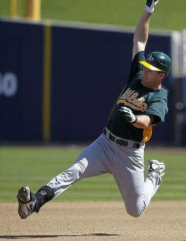 Seth Smith slides into second base with a double in the 4th inning of the Oakland A's Cactus League spring training game against the Milwaukee Brewers in Phoenix, Ariz. on Tuesday, March 6, 2012. Photo: Paul Chinn, The Chronicle
