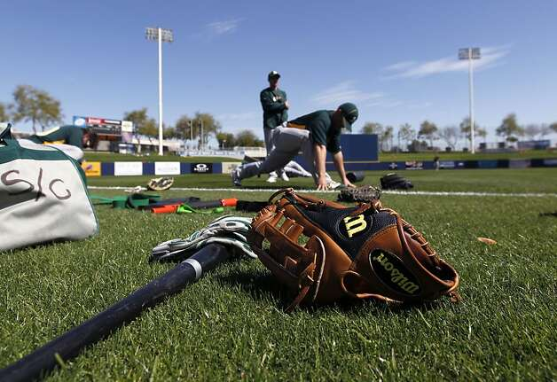 A's players stretch before the Oakland's Cactus League spring training game against the Milwaukee Brewers in Phoenix, Ariz. on Tuesday, March 6, 2012. Photo: Paul Chinn, The Chronicle
