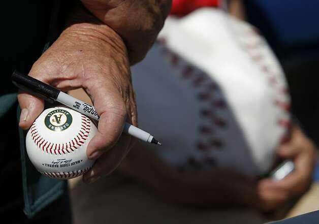 Ed Buck, from Oakhurst, Calif., seeks autographs from players before the Oakland A's Cactus League spring training game against the Milwaukee Brewers in Phoenix, Ariz. on Tuesday, March 6, 2012. Photo: Paul Chinn, The Chronicle