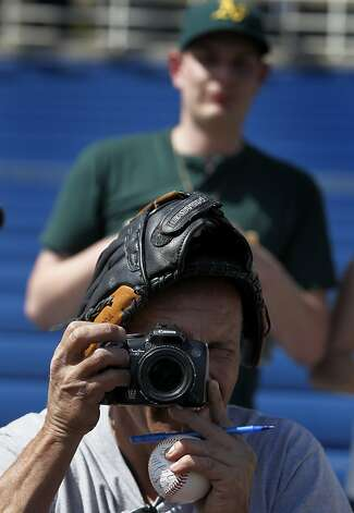 John Hazelton, of Phoenix snapped photos of players while seeking autographs before the Oakland A's Cactus League spring training game against the Milwaukee Brewers in Phoenix, Ariz. on Tuesday, March 6, 2012. Photo: Paul Chinn, The Chronicle
