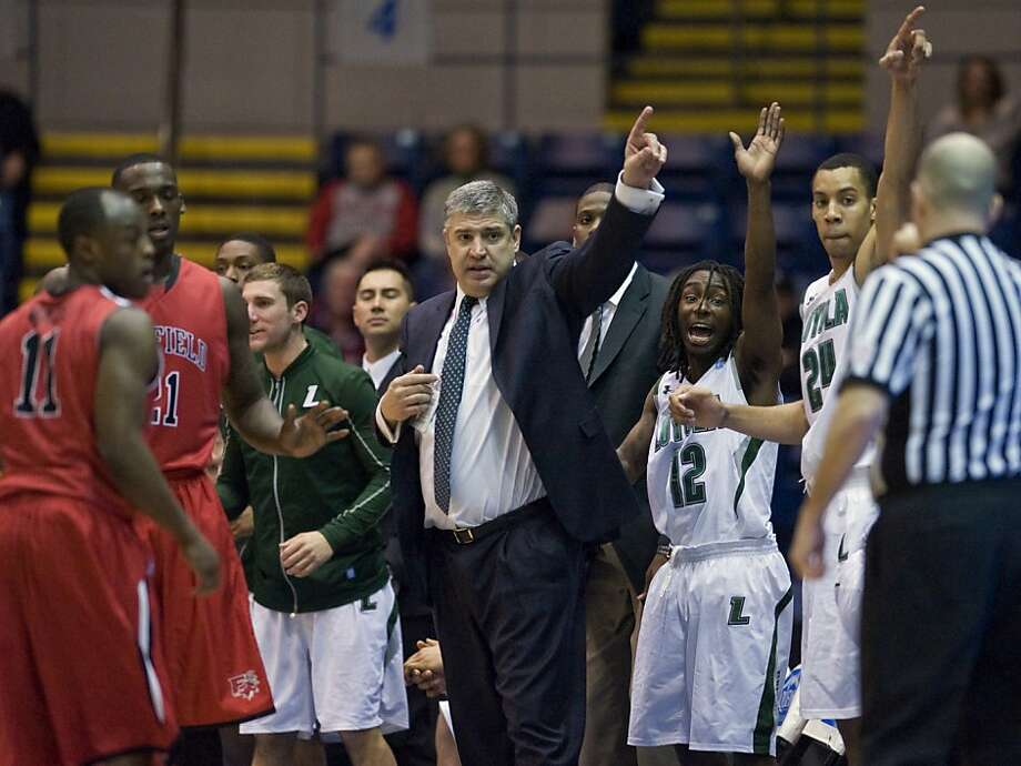 Loyola head coach Jimmy Patsos, center and his team gesture for possession to an official in the first half of an NCAA college basketball game against Fairfield for the championship of the Metro Atlantic Athletic Conference tournament in Springfield, Mass., Monday, March 5, 2012. Loyola won 48-44.  (AP Photo/Jessica Hill) Photo: Jessica Hill, Associated Press