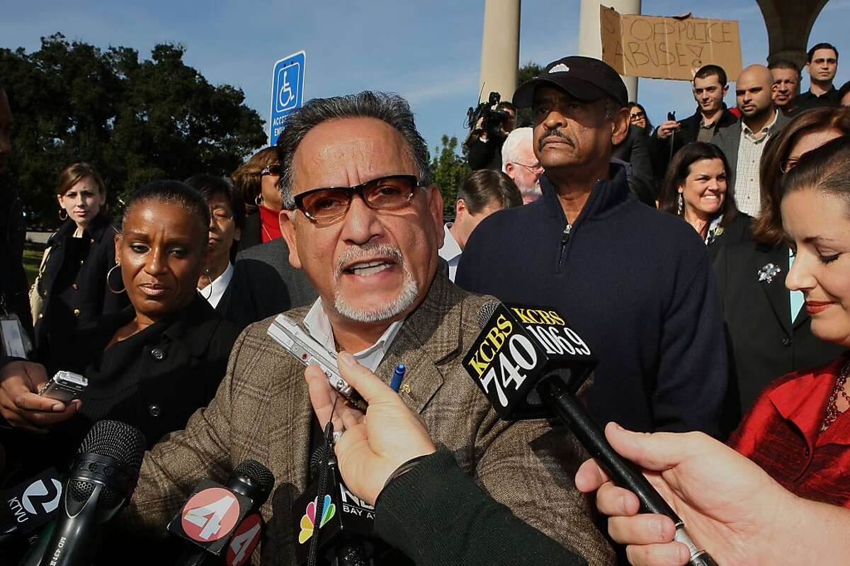 Oakland city council members Desley Brooks (left), Ignacio De La Fuente (front), Larry Reid (back,middle), Libby Schaaf (front, right) and several business owners met at the bandstand next to Lake Merritt in Oakland, Calif., as they try to voice their opinions over Occupy Oakland chants on Wednesday, November 9, 2011