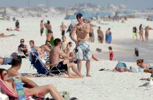 Spring breakers enjoy a warm and sunny day on Okaloosa Island beach in Fort Walton Beach, Fla. on Monday, March 5, 2012. (AP Photo/Northwest Florida Daily, Devon Ravine) Photo: Devon Ravine, Associated Press / Northwest Florida Daily News