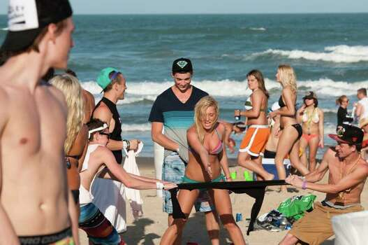 CORRECTS LOCATION - College students on spring break enjoy the warm weather as they visit the beach in South Padre Island, Fla.,  on Tuesday, March 6, 2012. (AP Photo/Valley Morning Star, Jesse Mendoza) Photo: Jesse Mendoza, Associated Press / Valley Morning Star