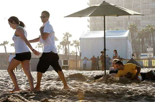 College students on spring break enjoy the warm weather as they visit the beach in South Padre Island, Fla.,  on Tuesday, March 6, 2012. (AP Photo/Valley Morning Star, Jesse Mendoza) Photo: Jesse Mendoza, Associated Press / Valley Morning Star