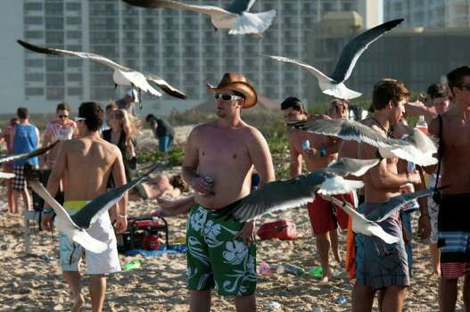 CORRECTS LOCATION--College students on spring break enjoy the warm weather as they visit the beach in South Padre Island, Texas., on Tuesday, March 6, 2012. (AP Photo/Valley Morning Star, Jesse Mendoza) Photo: Jesse Mendoza, Associated Press / Copyright 2012 The Associated Press. All rights reserved. This material may not be published, broadcast, rewritten or redistribu