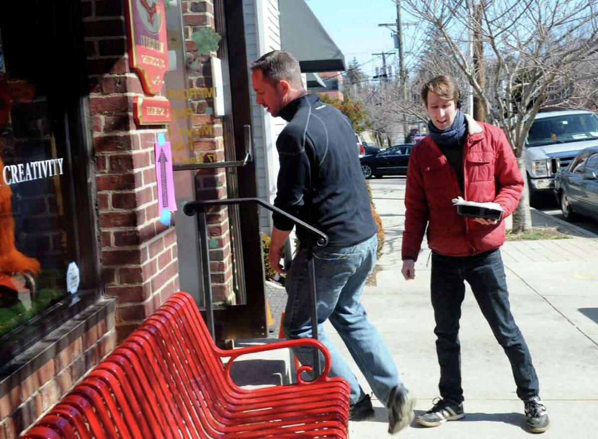 """Thomas Deming, right, of New York City, a production assistant for Showtime's """"The Big C"""" grabs lunchs on East Elm Street Tuesday, March 6, 2012."""