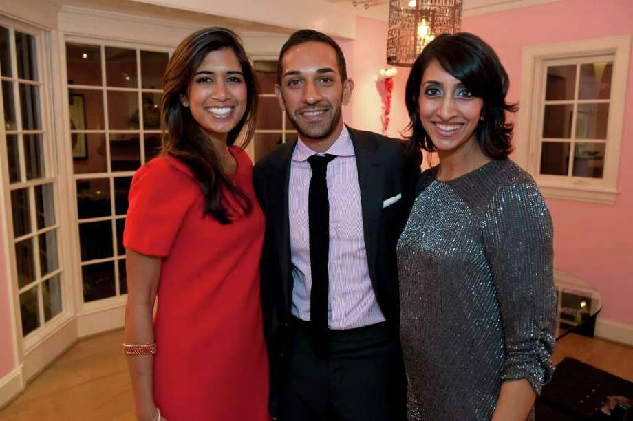 Event chair Divya Brown, left, Suchit Majmudar and Reena Patel at the home of Judy and Scott Nyquist for the Spotlight Asia kickoff party Thursday, Feb. 23, 2012. Photo: Jeff Fantich