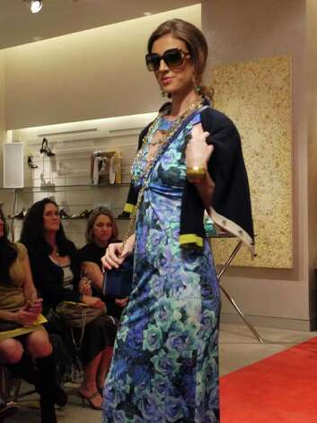 A blue floral print maxi dress is accessorized with gold jewelry and a color-blocked cardigan is worn by a model at a Neiman Marcus Spring 2012 fashion show at the Shops at La Cantera. Photo: Michael Quintanilla/San Antonio Express-News / Michael Quintanilla