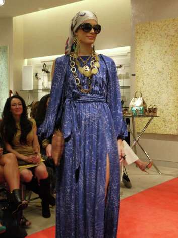 A Neiman Marcus model wears a blue print maxi dress with slits at the shoulders and legs during the Spring 2012 Neiman Marcus Spring fashion show at the Shops at La Cantera. Photo: Michael Quintanilla/San Antonio Express-News  / Michael Quintanilla