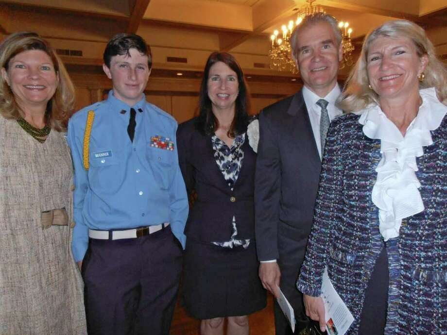 LeAnn Billups, from left, John Luke Mannix, his mother Francie Mannix, Jamie Billups and Liza Lewis - all siblings except for John Luke - gathered after the Operation Comfort luncheon honoring their mother, Frances Billups. Photo: Nancy Cook-Monroe, For The Express-News