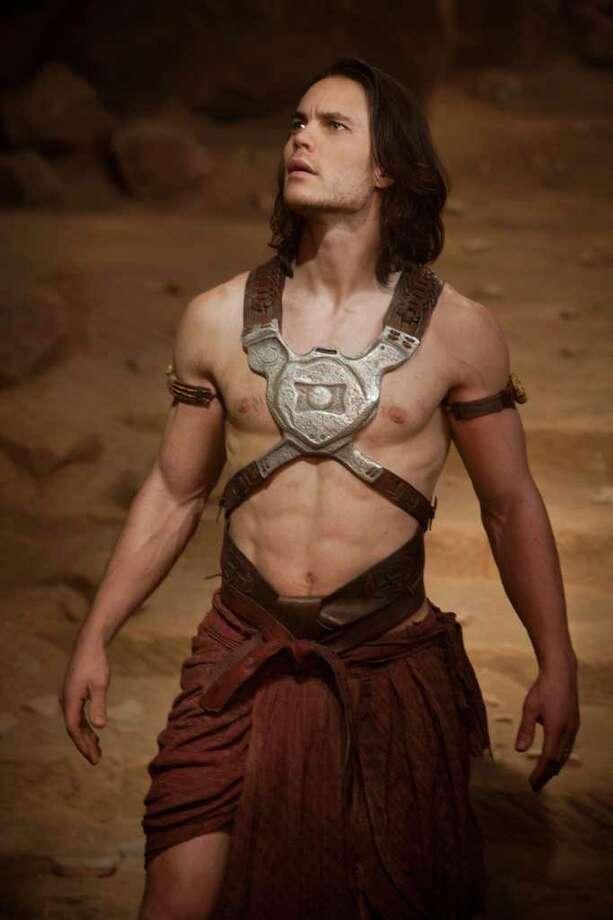 """John Carter"" (Taylor Kitsch) offers a sword-wielding fantasy on Mars. Photo: Disney / ©2011 Disney. JOHN CARTERô ERB, Inc."