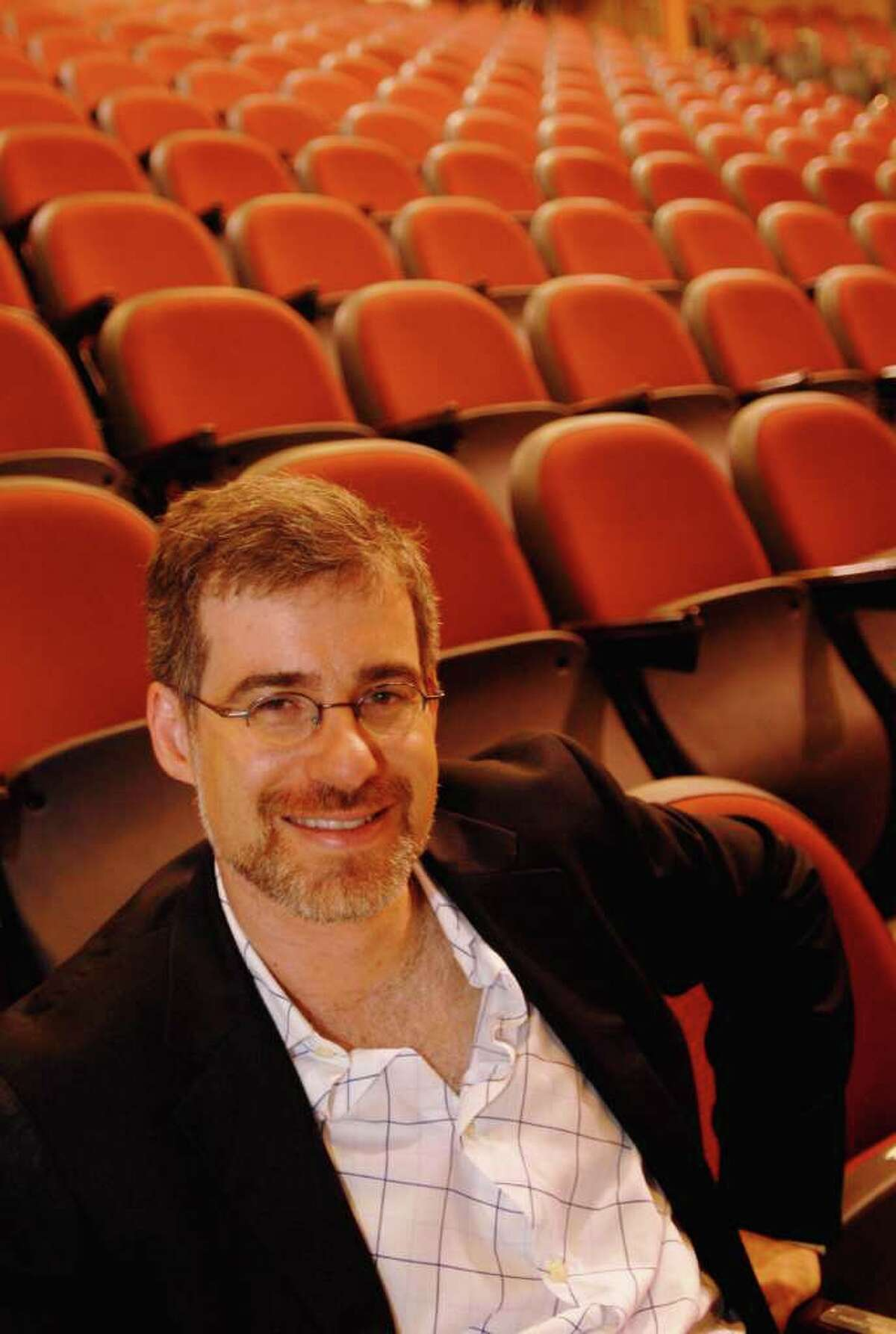 TIMES UNION STAFF PHOTO BY: LUANNE M. FERRIS--Thursday, June 26, 2008, Glens Falls, NY, Mark Fleischer, cq., the Producing Artistic Director of the Adirondack Theatre Festival, which runs through July, with it's shows in the Charles R. Wood Theater, cq., in downtown Glens Falls, NY, in the front row of the theater, on Thursday, June 26, 2008.