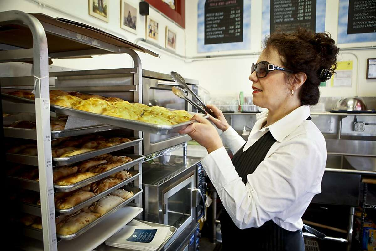 Paula Tejeda, owner of Chile Lindo, prepares an emapanada on Friday, March 2, 2012 in San Francisco, Calif.
