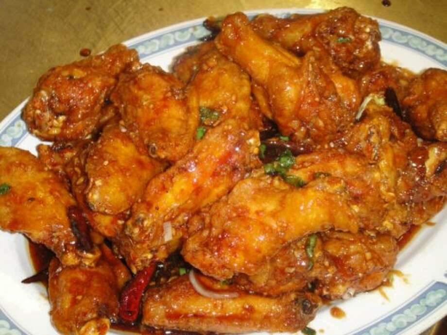 San Tung: Yeah, with its dry-fried chicken wings ($10 for 12), the popular Inner Sunset spot probably has the most famous chicken dish this side of Zuni Cafe. The wings are expertly fried and glazed with a sweet ginger-garlic sauce, but the menu goes beyond poultry; the cold plates and appetizers section of the menu is vastly underappreciated.  Vitals: 1031 Irving St. (near 11th Avenue), S.F.; (415) 242-0828. www.santungrestaurant.com. Lunch and dinner Thursday-Tuesday.