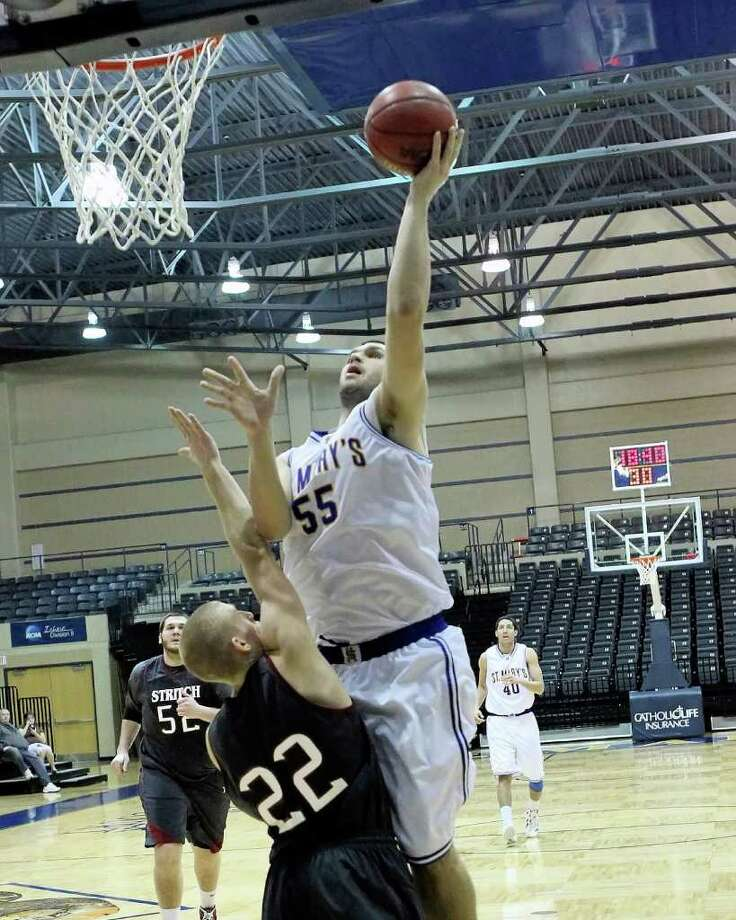 St. Mary's center Kevin Kotzur takes it to the hoop in 2012 game action vs. Stritch. Photo: Antonio Morano / Antonio Morano Photography