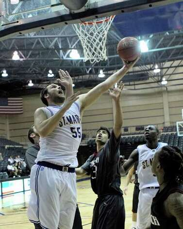 St. Mary's center Kevin Kotzuer takes it to the hoop in 2012 game action vs. Stritch. Photo: Antonio Morano / Antonio Morano Photography