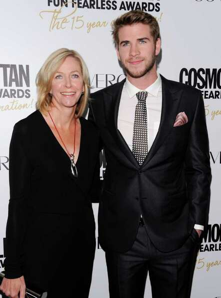 Honoree, actor Liam Hemsworth and his mother Leonie attend Cosmopolitan Magazine's